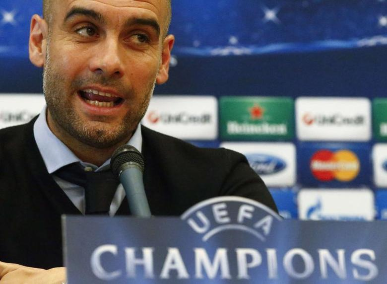 Bayern Munich's coach Pep Guardiola addresses a news conference at the team's hotel in Madrid April 22, 2014. Bayern Munich will play Real Madrid in their Champion's League semi-final first leg soccer match in Madrid on Wednesday.  REUTERS/Michael Dalder