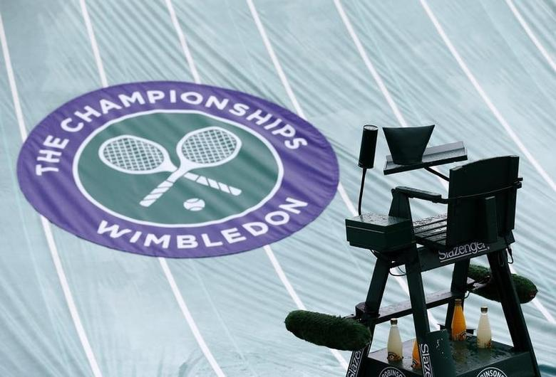 The rain covers protect a court at the Wimbledon Tennis Championships, in London June 28, 2013.       REUTERS/Eddie Keogh