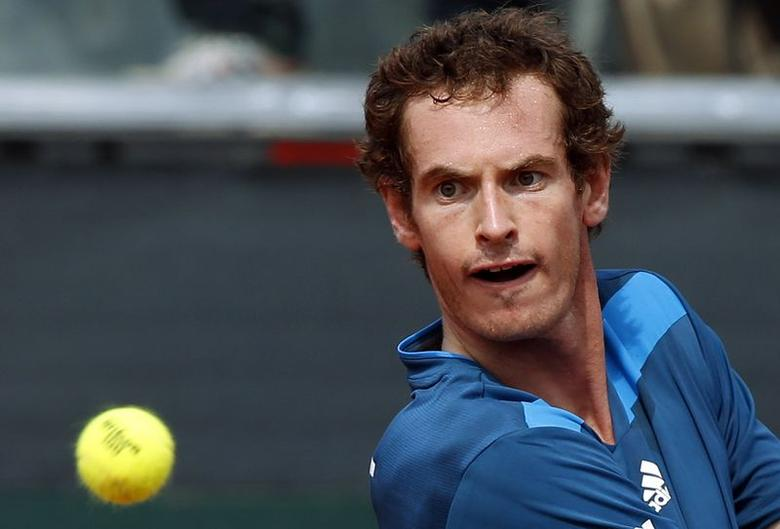 Britain's Andy Murray returns a shot against Italy's Andreas Seppi during their Davis Cup quarter-final tennis match in Naples April 5, 2014. REUTERS/Alessandro Bianchi