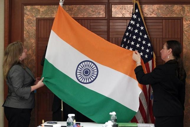 Technical Sergeant Julie Taylor (R) and Shanan Guinn from the U.S. Department of Defense display the flags of India and the United States before a bilateral meeting between U.S. Defense Secretary Robert Gates and Indian National Security Advisor Shiv Shankar Menon during the Shangri-La Dialogue Asia Security Summit in Singapore June 4, 2010. REUTERS/Carolyn Kaster/Pool/Files