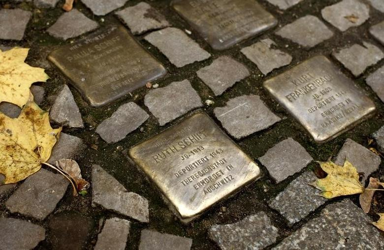 So-called 'Stolpersteine' (stumbling blocks), memorial pavement plaques commemorating German Jews who died in the concentration camps of Auschwitz and Theresienstadt, are pictured in Berlin's Wilmersdorf district November 7, 2008. German artist Gunter Demnig has embedded into pavements across Germany, Austria, Hungary and the Netherlands where Jews were living during the Nazi era.        REUTERS/Fabrizio Bensch (GERMANY) - RTXAD55