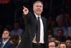 Nov 12, 2013; Los Angeles, CA, USA; Los Angeles Lakers coach Mike D'Antoni reacts in the first half against the New Orleans Pelicans at Staples Center. Mandatory Credit: Kirby Lee-USA TODAY Sports