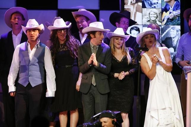 Cast members of ''The Big Bang Theory'' take the stage along with others to end the night wearing cowboy hats in honor of country music singer Glen Campbell during the 22nd annual ''A Night at Sardi's'' to benefit the Alzheimer's Association at the Beverly Hilton Hotel in Beverly Hills, California, March 26, 2014. REUTERS/Danny Moloshok/Files