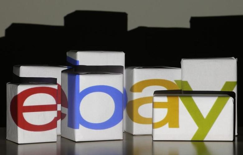 An eBay logo is projected onto white boxes in this illustration picture taken in Warsaw, January 21, 2014. Reuters/Kacper Pempel/Files