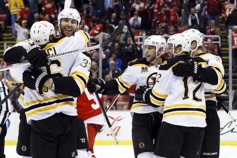 Apr 24, 2014; Detroit, MI, USA; Boston Bruins wing Jarome Iginla (12) celebrates with center David Krejci (46) , defenseman Zdeno Chara (33) , left wing Milan Lucic (17) and defenseman Dougie Hamilton (27) after the game-winning goal in overtime against the Detroit Red Wings in game four of the first round of the 2014 Stanley Cup Playoffs at Joe Louis Arena.  Rick Osentoski-USA TODAY Sports