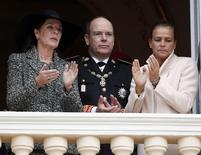 From L-R, Princess Caroline of Hanover, Prince Albert II of Monaco and Princess Stephanie are seen at the Palace balcony during Monaco's National Day November 19, 2013.     REUTERS/Eric Gaillard
