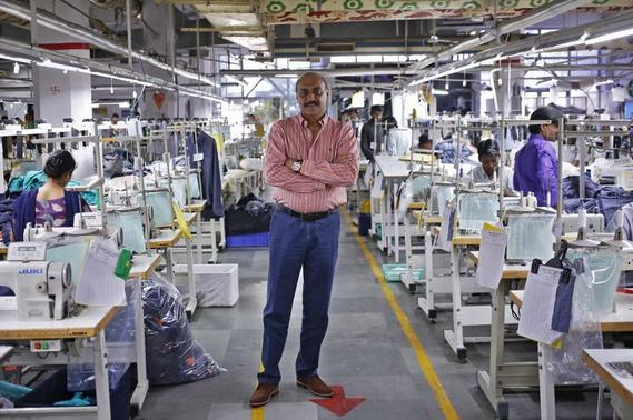 Sudhir Dhingra, chairman and managing director of Orient Craft Ltd., poses for a picture inside his textile mill at Gurgaon in Haryana April 16, 2014. REUTERS/Anindito Mukherjee