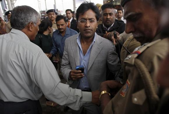 Lalit Modi, former chairman of Indian Premier League (IPL), leaves an airport in New Delhi April 28, 2010. REUTERS/Adnan Abidi/Files