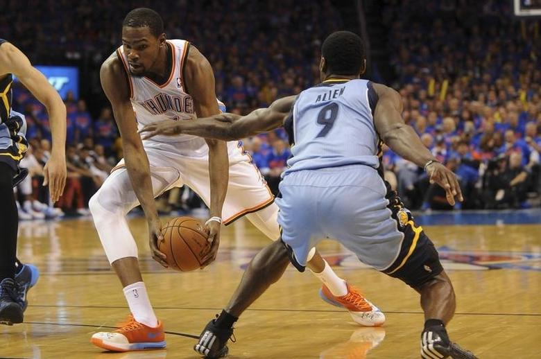 May 3, 2014; Oklahoma City, OK, USA; Oklahoma City Thunder forward Kevin Durant (35) drives to the basket against Memphis Grizzlies guard Tony Allen (9) during the fourth quarter in game seven of the first round of the 2014 Mandatory Credit: Mark D. Smith-USA TODAY Sports - RTR3NOW8