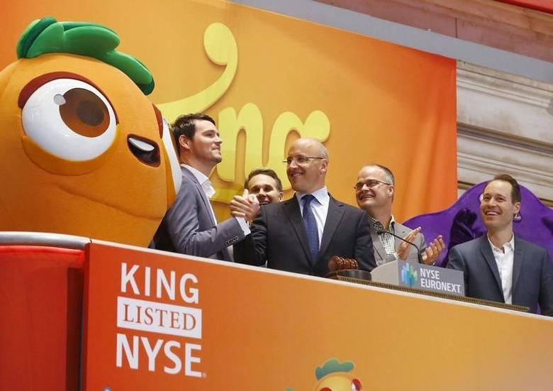 (L-R) King CTO Thomas Hartwig, CEO Riccardo Zacconi, COO Stephane Kurgan and Chief Creative Officer Sebastian Knutsson celebrate during the IPO of Mobile game maker King Digital Entertainment Plc on the floor of the New York Stock Exchange March 26, 2014.    REUTERS/Brendan McDermid