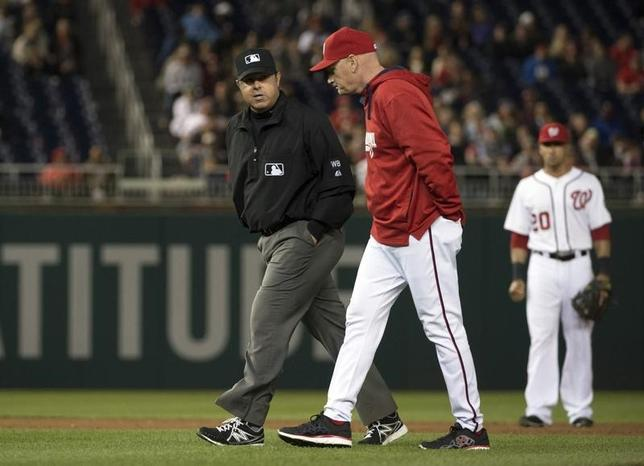 Apr 24, 2014; Washington, DC, USA; Washington Nationals manager Matt Williams (9) speaks with umpire Doug Eddings (88) prior to challenging a call in the ninth inning against the San Diego Padres at Nationals Park. San Diego Padres defeated Washington Nationals 4-3. Mandatory Credit: Tommy Gilligan-USA TODAY Sports - RTR3MJVI