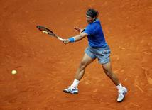Rafael Nadal of Spain returns the ball to Juan Monaco of Argentina during their match at the Madrid Open tennis tournament May 7, 2014. REUTER/Susana Vera