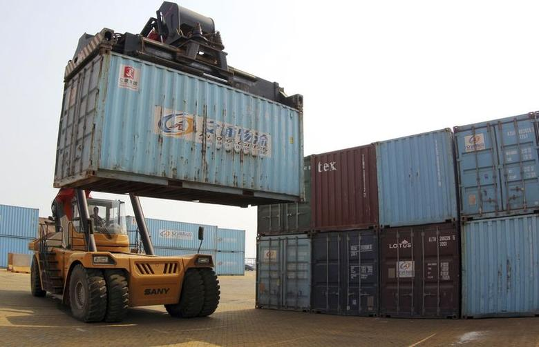 A forklift transfers a shipping container for export at a port in Lianyungang, Jiangsu province May 5, 2014. REUTERS/China Daily