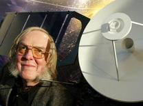 Britain's Professor Colin Pillinger, lead scientist for the Beagle 2 mission to Mars, stands in front of a 1:4 scale model of the Mars Express spacecraft at a news conference in central London, January 26, 2004. REUTERS/File