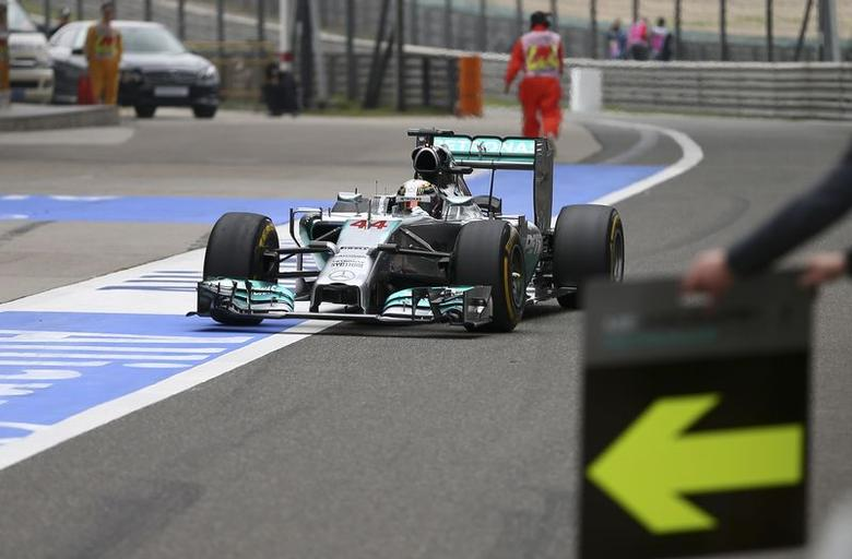Mercedes Formula One driver Lewis Hamilton of Britain drives to a pit stop during the Chinese F1 Grand Prix at the Shanghai International Circuit April 20, 2014. REUTERS/Suki Srdjan/Pool (CHINA - Tags: SPORT MOTORSPORT F1) - RTR3LZ65