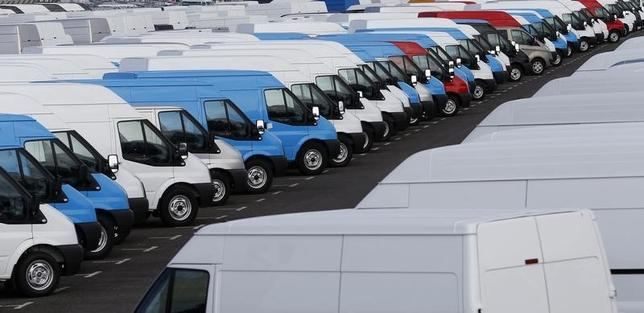 Vans are seen parked in a dockyard at Southampton Docks in southern England April 23, 2013. REUTERS/Eddie Keogh