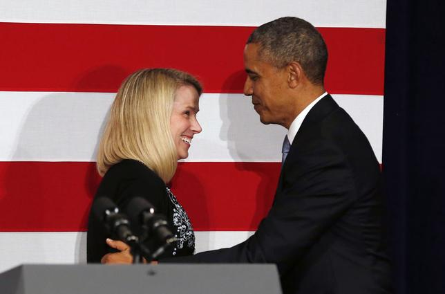 U.S. President Barack Obama is introduced to speak by Yahoo CEO Marissa Mayer at a DNC fund raiser in San Jose, California May 8, 2014. REUTERS/Kevin Lamarque