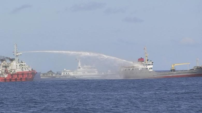 A Chinese ship (L) uses water cannon on a Vietnamese Sea Guard ship on the South China Sea near the Paracels islands, in this handout photo taken on May 3, 2014 and released by the Vietnamese Marine Guard on May 8, 2014. REUTERS/Vietnam Marine Guard/Handout via Reuters