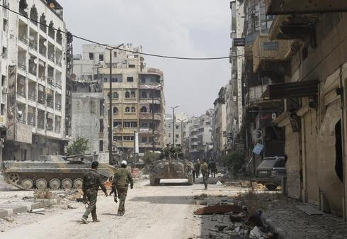 Syrian rebels abandon Homs