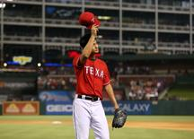 May 9, 2014; Arlington, TX, USA; Texas Rangers starting pitcher Yu Darvish (11) tips his hat to the crows after giving up his only hit and being relieved in the ninth inning against Boston Red Sox designated hitter David Ortiz (not pictured) at  Global Life Park in Arlington. The Rangers beat the Red Sox 8-0. Mandatory Credit: Matthew Emmons-USA TODAY Sports