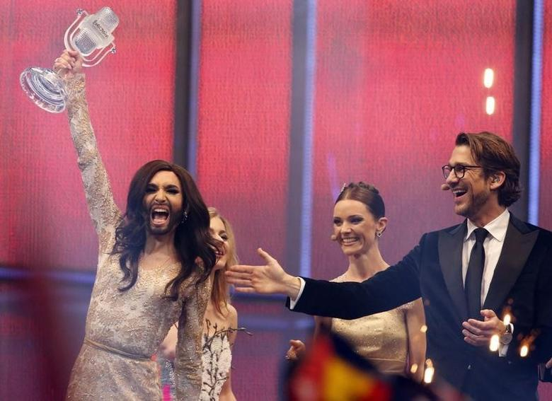 Conchita Wurst (L) representing Austria celebrates after winning the grand final of the 59th Eurovision Song Contest at the B&W Hallerne in Copenhagen May 10, 2014.                         REUTERS/Tobias Schwarz