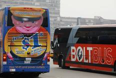 A Megabus and a Boltbus buses cross paths in New York City May 8, 2014.      REUTERS/Eduardo Munoz