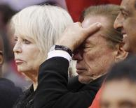 Los Angeles Clippers owner Donald Sterling (R) puts his hand over his face as he sits courtside with his wife Shelly (L) while the Clippers trail the Chicago Bulls in the second half of their NBA basketball game in Los Angeles December 30, 2011. REUTERS/Danny Moloshok