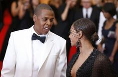 "Jay Z and Beyonce Knowles arrive at the Metropolitan Museum of Art Costume Institute Gala Benefit celebrating the opening of ""Charles James: Beyond Fashion"" in Upper Manhattan, New York, May 5, 2014.    REUTERS/Lucas Jackson"