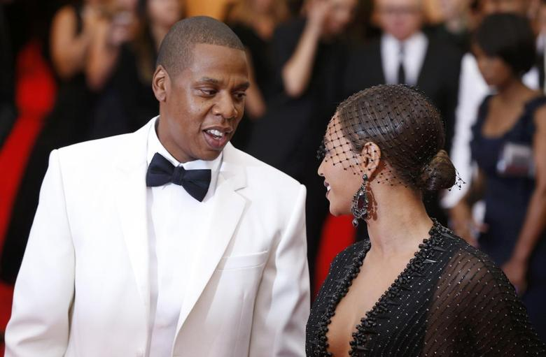 Jay Z and Beyonce Knowles arrive at the Metropolitan Museum of Art Costume Institute Gala Benefit celebrating the opening of ''Charles James: Beyond Fashion'' in Upper Manhattan, New York, May 5, 2014.    REUTERS/Lucas Jackson