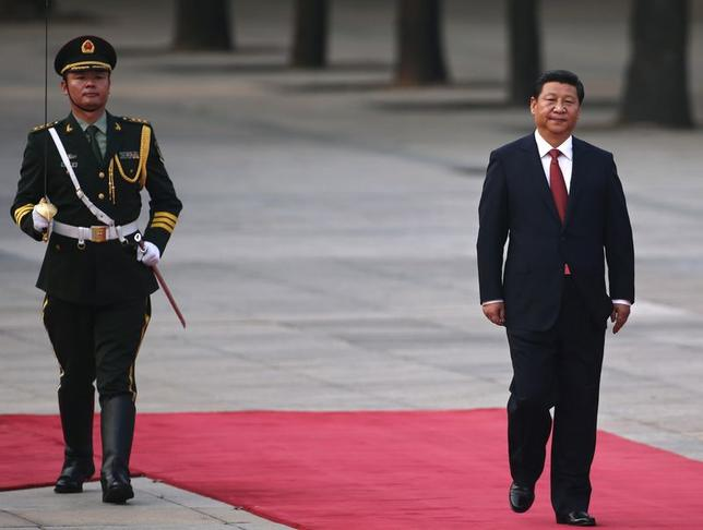 China's President Xi Jinping walks next to a honour guard during the welcoming ceremony for Serbian President Tomislav Nikolic outside the Great Hall of the People in Beijing August 26, 2013. REUTERS/Petar Kujundzic