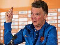 The Netherlands coach Louis van Gaal reacts during a news conference in Hoenderloo May 13, 2014. REUTERS/Michael Kooren