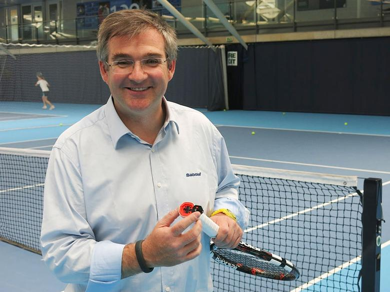 Eric Babolat, CEO and Chairman of Babolat, poses for a photograph holding a hi-tech, 'connected' tennis racquet at Britain's National Tennis Centre in Roehampton, south-west London, May 12, 2014.   REUTERS/Ossian Shine