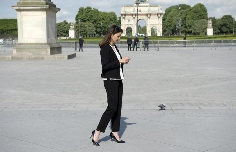 French Culture Minister Aurelie Filippetti looks at her mobile phone after a visit at the exhibition ''Birth of a museum'', at the Louvre museum in Paris April 29, 2014.  REUTERS/Alain Jocard/Pool