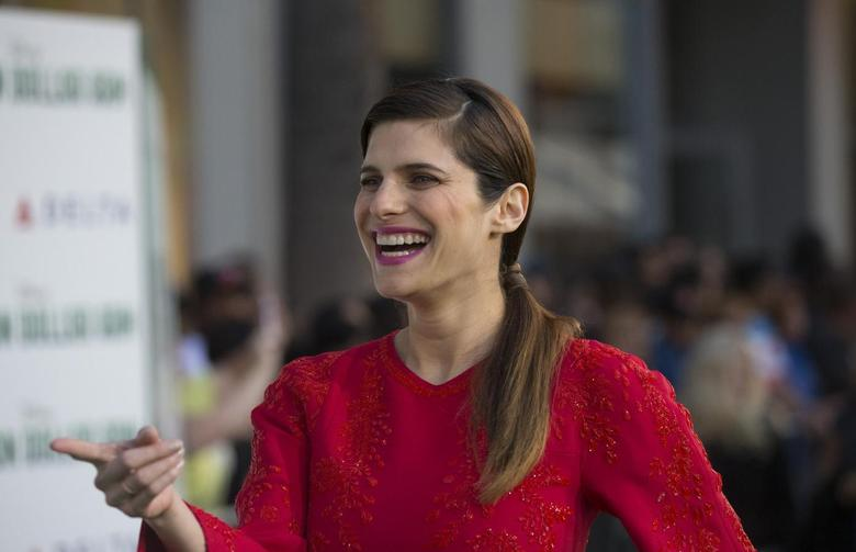 Cast member Lake Bell smiles at the premiere of ''Million Dollar Arm'' at El Capitan theatre in Hollywood, California May 6, 2014.   REUTERS/Mario Anzuoni