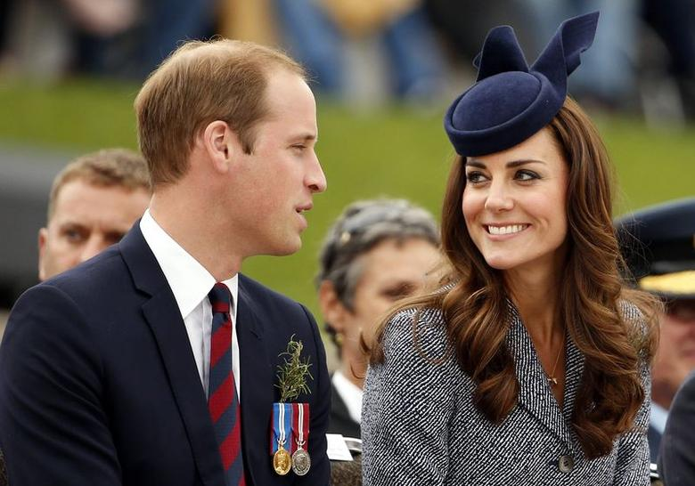 Britain's Prince William and his wife Catherine, the Duchess of Cambridge, talk during an ANZAC Day service at the Australian War Memorial in Canberra April 25, 2014. REUTERS/Phil Noble/Files
