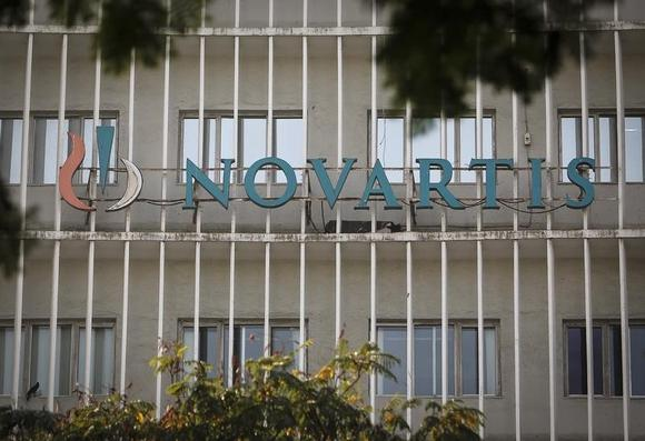 A Novartis logo is pictured on its headquarters building in Mumbai February 6, 2014. REUTERS/Danish Siddiqui/Files