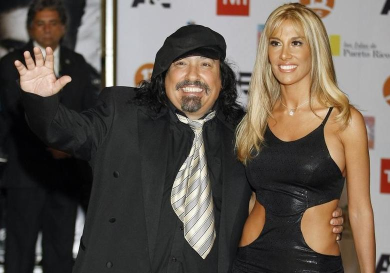 Miguel Pinera Echenique, brother of Chilean President Sebastian Pinera, poses with his wife Argentine model Belen Hidalgo at the International Song Festival in Vina del Mar city February 19, 2010. REUTERS/Eliseo Fernandez