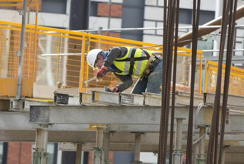 A construction worker works on a site in London February 19, 2014.  REUTERS/Neil Hall