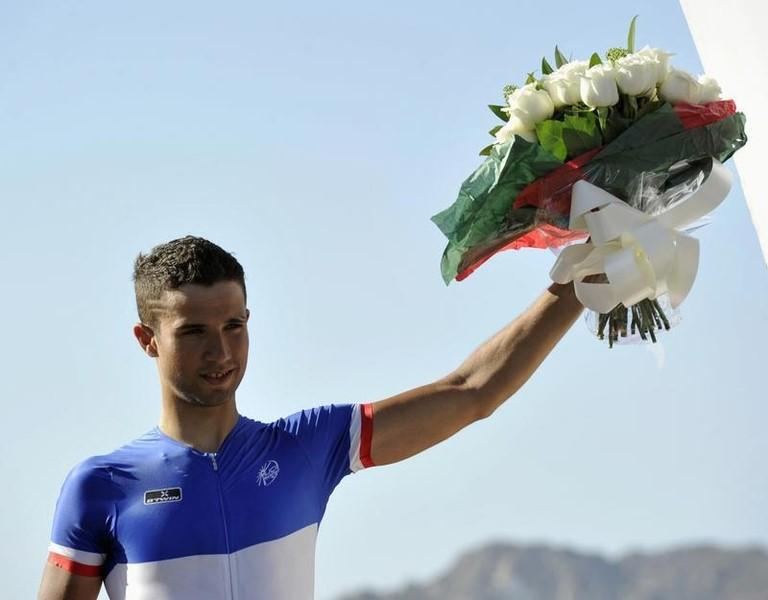 France's Nacer Bouhanni of UCI ProTeam FDJ celebrates winning the 144km (90 miles) sixth and final stage of the Tour of Oman cycling race from Hawit Nagam Park to Matrah Corniche in Muscat February 16, 2013. REUTERS/Sultan Al Hasani
