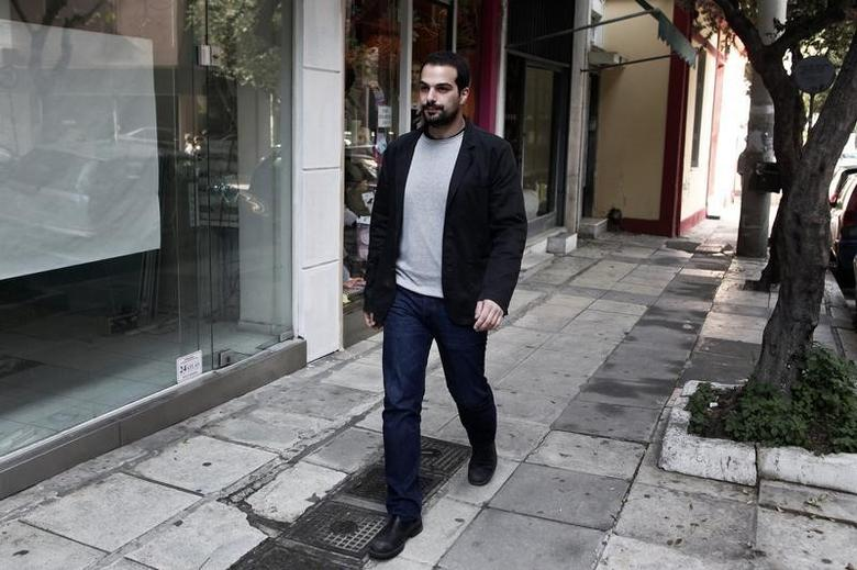 Syriza party's candidate for the Athens municipal election Gabriel Sakellaridis walks in a neighbourhood during his electoral campaign in Athens April 8, 2014.   REUTERS/Alkis Konstantinidis