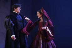 "Actors Ben Miles (as Thomas Cromwell) and Lydia Leonard (as Anne Boleyn) perform in an adaptation of Hilary Mantel's books ""Wolf Hall"" and ""Bring Up the Bodies"" during a photocall at the Aldwych Theatre in London May 15, 2014. REUTERS/Luke MacGregor"