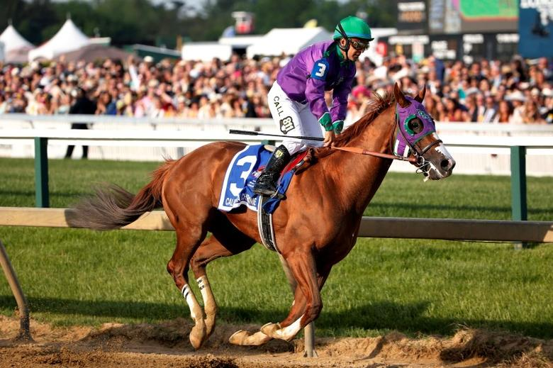 May 17, 2014; Baltimore, MD, USA; Victor Espinoza aboard California Chrome goes around the first turn after winning the 139th Preakness Stakesat Pimlico Race Course. Mandatory Credit: Winslow Townson-USA TODAY Sports