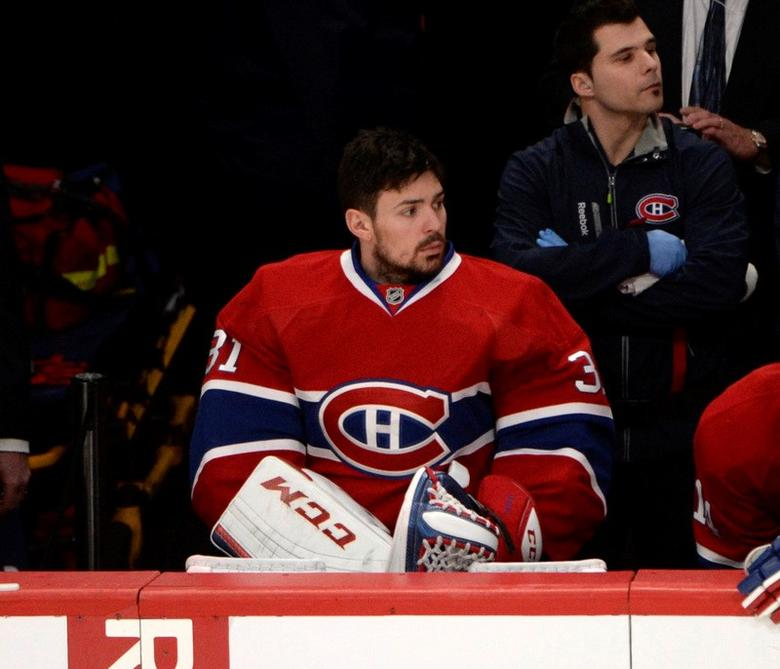 May 17, 2014; Montreal, Quebec, CAN; Montreal Canadiens goalie Carey Price (31) benched during the third period in game one of the Eastern Conference Finals of the 2014 Stanley Cup Playoffs against the New York Rangers at the Bell Centre. Mandatory Credit: Eric Bolte-USA TODAY Sports