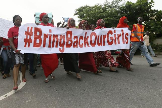 Nigerians take part in a protest demanding for the release of secondary school girls abducted from the remote village of Chibok, in Asokoro, Abuja May 13, 2014.  REUTERS/Afolabi Sotunde