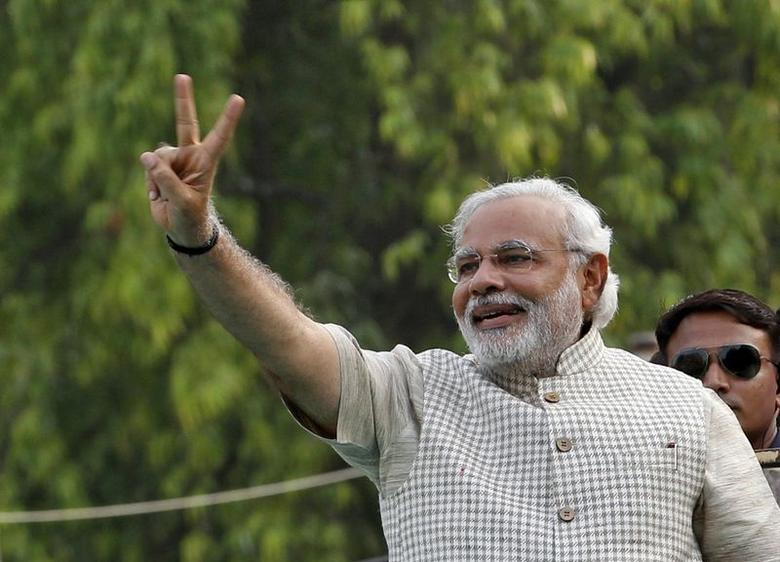 Narendra Modi gestures during a public meeting in Vadodra, in Gujarat May 16, 2014. REUTERS/Amit Dave