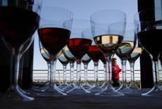 A woman attends the Vivanda Taste the Med food festival as glasses of red and white wine are placed on a display table at Ta' Qali, outside Valletta November 6, 2011. REUTERS/Darrin Zammit Lupi