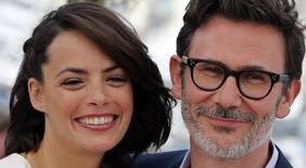 "Director Michel Hazanavicius (R) and cast member Berenice Bejo pose during a photocall for the film ""The Search"" in competition at the 67th Cannes Film Festival in Cannes May 21, 2014.  REUTERS/Eric Gaillard"