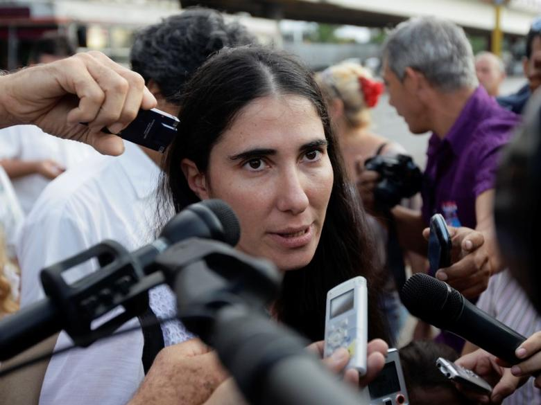 Cuba's best-known dissident, blogger Yoani Sanchez, speaks to reporters outside Havana's Jose Marti International Airport May 30, 2013. REUTERS/Desmond Boylan/Files