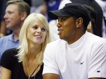 Tiger Woods and his wife Elin Nordegren (L) watch Game 4 of the NBA Finals basketball game in Orlando, Florida in this June 11, 2009, file photo.   REUTERS/Hans Deryk/Files