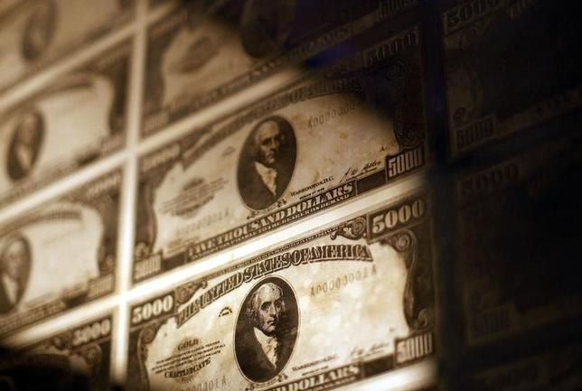 United States money printing plates are seen at the Museum of American Finance in New York October 15, 2010. REUTERS/Shannon Stapleton/Files